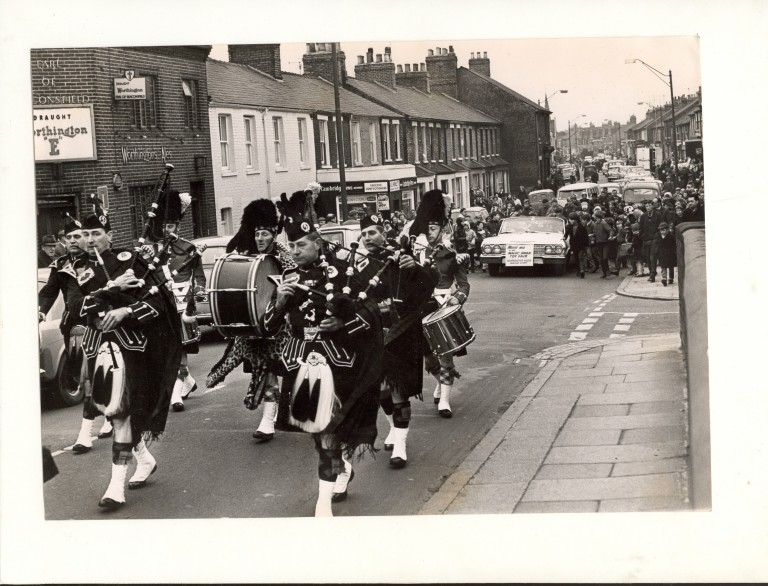 Band passing the Earl of Beaconsfield
