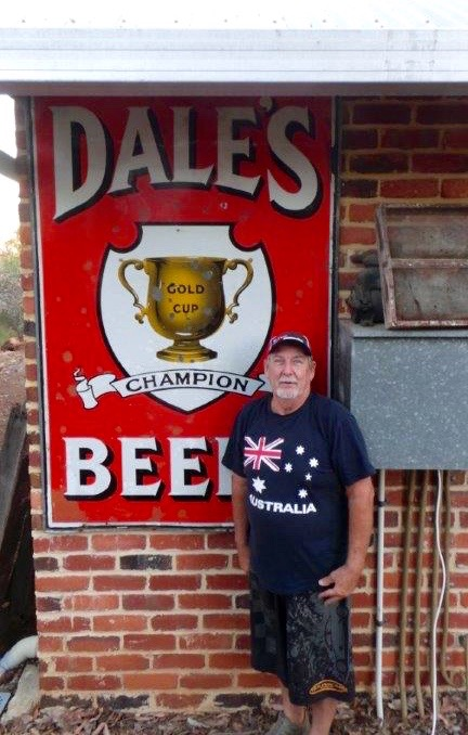 Dale Miller with a Dale's Brewery sign